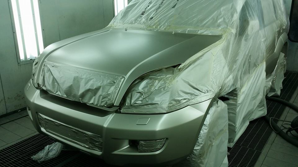 Car in a drying booth
